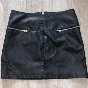 Mini black leather skirt